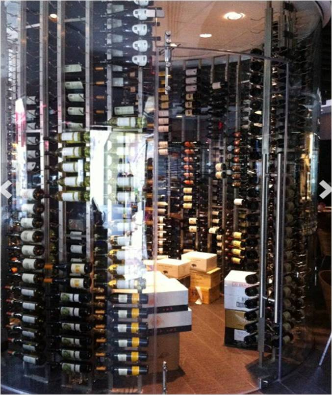 Glass-Enclosed Glass Commercial Wine Cellar with VintageView Custom Wine Racks Built by Trusted Installers