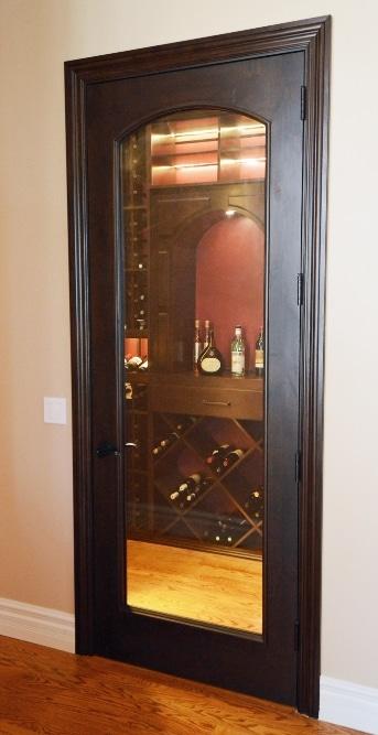 The Custom Wine Cellar Door Complements the Wood Wine Racks
